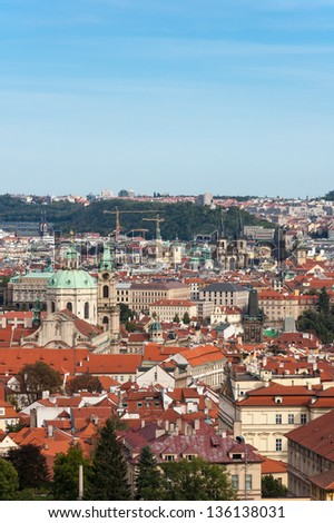 red roofs and cityscape of golden Prague