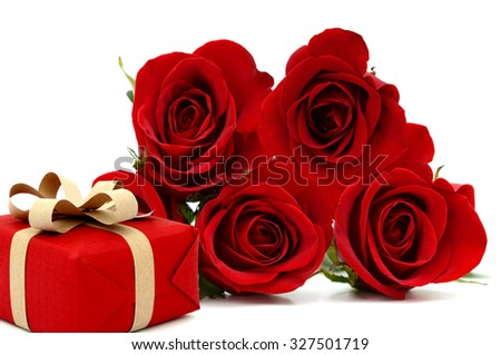 red rose with gift box, lay down on white table - stock photo