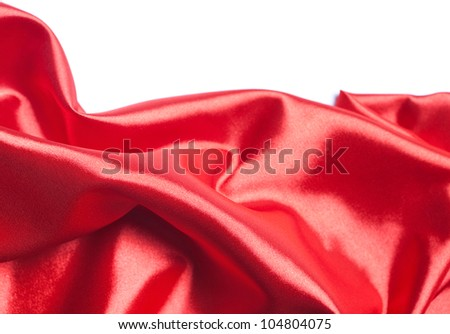 red silk fabric over white background - stock photo