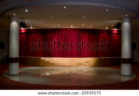 """Red stage curtain with light and shadow"" - stock photo"