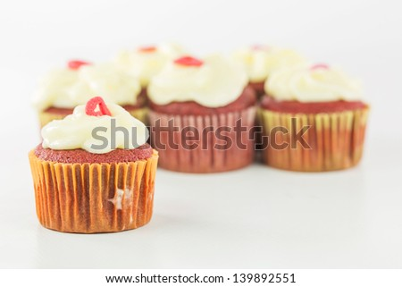 Red velvet cupcakes with sugar glazing