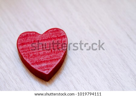 Red wooden heart. Valentine's Day.
