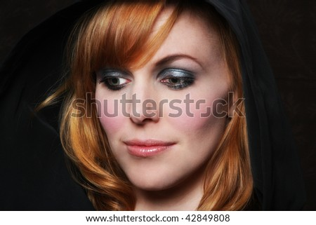 redhead in thoughtful pose  - fresh  with makeup applied