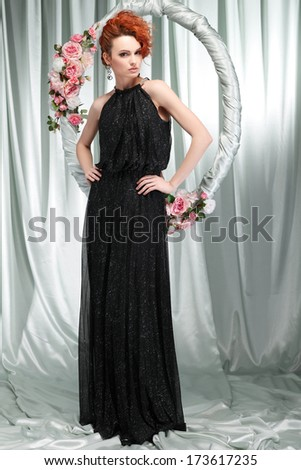 redheaded girl in evening dress  with the hoop with pink flowers - stock photo