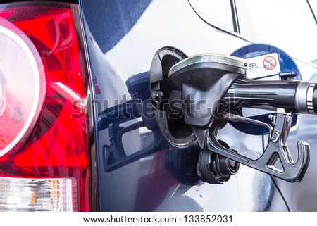 Refilling car fuel on the gas station - stock photo