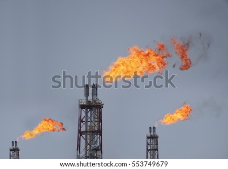 refinery fire gas torch on sky background