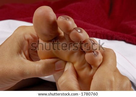 Reflexology Foot Massage by Masseuse - stock photo