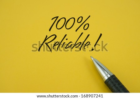 100% Reliable note with pen on yellow background - stock photo