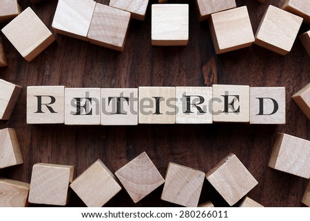 retired word concept on wooden block - stock photo