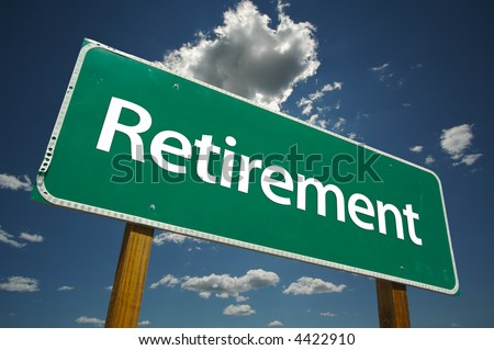 """""""Retirement"""" Road Sign with dramatic blue sky and clouds. - stock photo"""