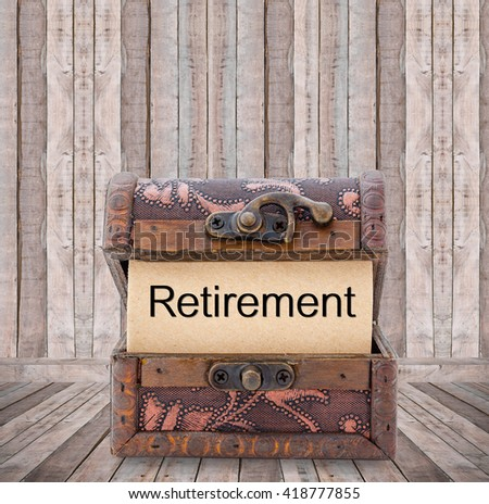 Retirement word on paper in treasure chest on wooden room. - stock photo