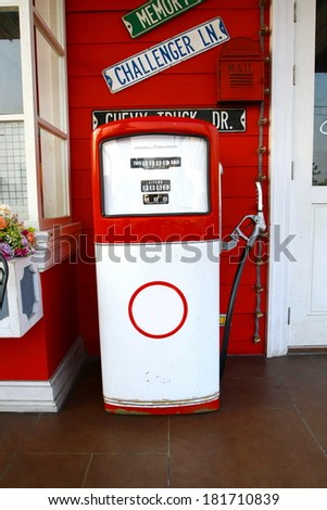 retro red oil pump station - stock photo