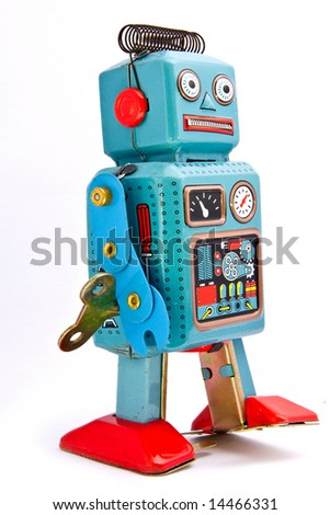 retro robot toys on white - stock photo