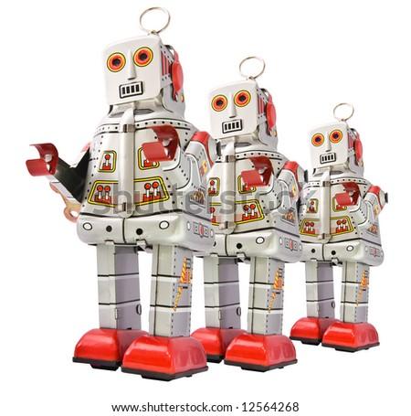 retro robots on the go - stock photo