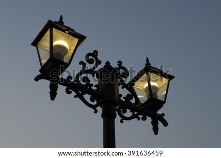 retro street light lamp post at dusk - stock photo