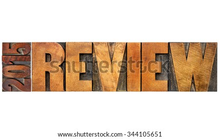 2015 review banner - annual review or summary of the recent year - isolated word abstract in letterpress wood type blocks - stock photo