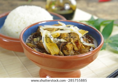 rice and sauce on mat background - stock photo