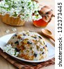 Rice pudding with raisins, prunes and apricots, decorated with flowers - stock photo