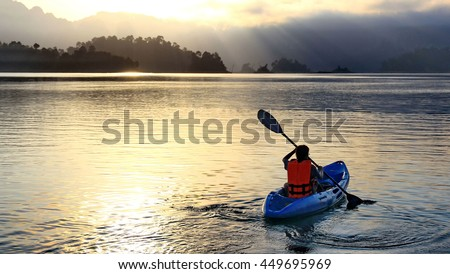 Riding canoe in river