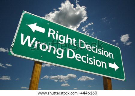 """Right Decision, Wrong Decision"" Road Sign with dramatic blue sky and clouds. - stock photo"