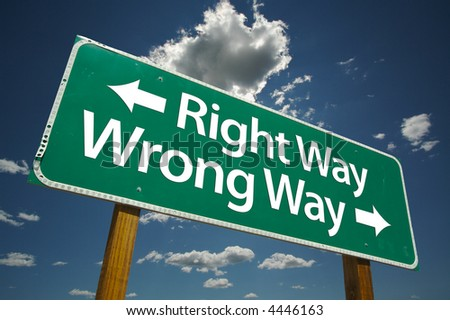 """Right Way, Wrong Way"" Road Sign with dramatic blue sky and clouds. - stock photo"