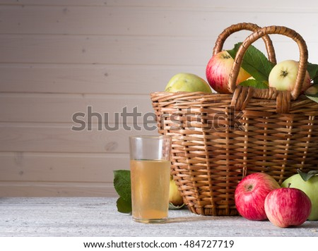 ripe pears and apples on wooden table