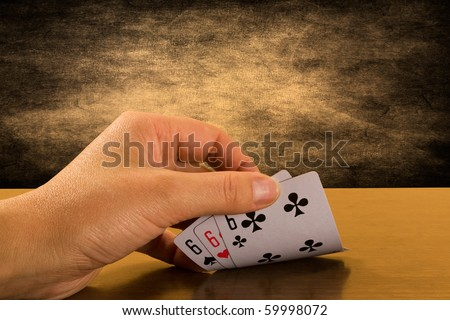 risk and success . Player hand revealing triple six