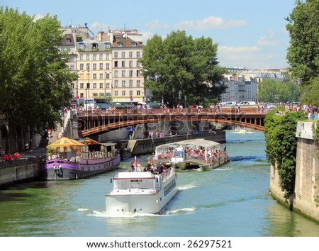 river Seine,  bridge Pont au Double,  walking ships, paris - stock photo