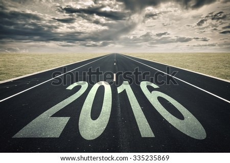 2016 Road perspective, dark clouds, crisis concept - stock photo