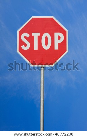Road sign Stop, on sky background - stock photo