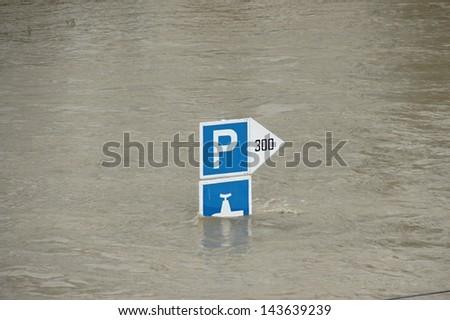 Road sign under water - extraordinary flood, on Danube in Bratislava, Slovakia - stock photo