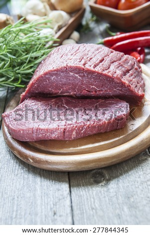 Roast beef ready to be cooked - stock photo