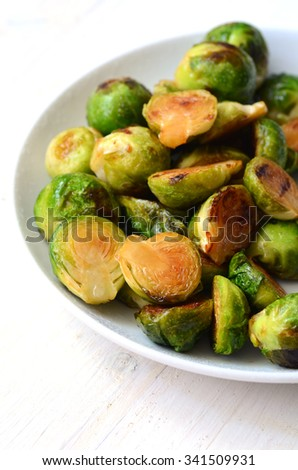 Roasted Brussel Sprouts with honey and balsamic vinegar - stock photo