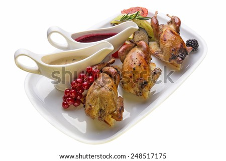 Roasted quail with vegetables on white background - stock photo