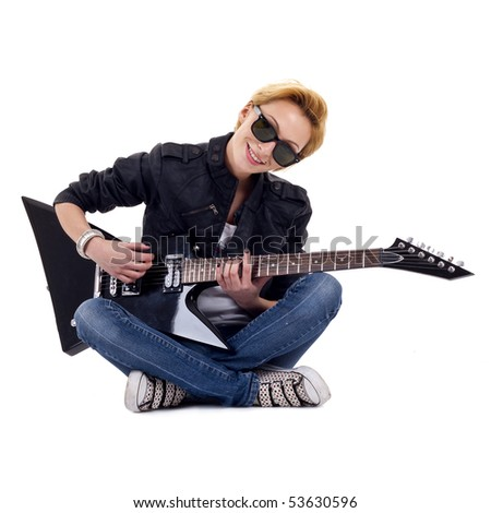 rock girl playing an electric guitar sitting down - stock photo