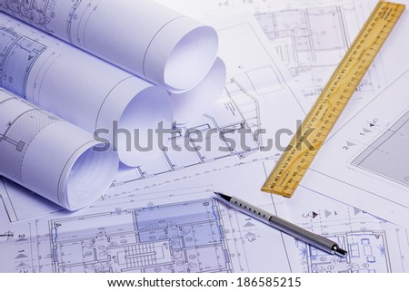 rolls of architectural house plans - stock photo
