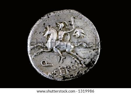 Roman republican denarius of M. Sergius Silus. 116 BC. A horseman is galloping   while holding a sword and the head of a barbarian in his left hand. Q M SERGI is below and SILVS is in the exergue. - stock photo