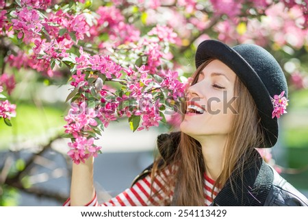 Romantic young woman in spring garden - stock photo