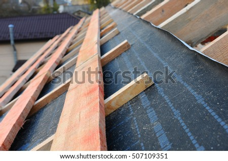 Roof Contractor Repair. Wooden Roof Construction. House Building.  Installation Of Wooden Beams At