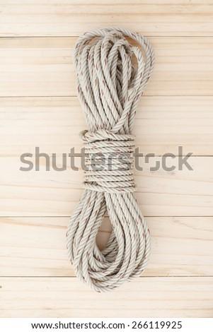 Rope on wood background - stock photo
