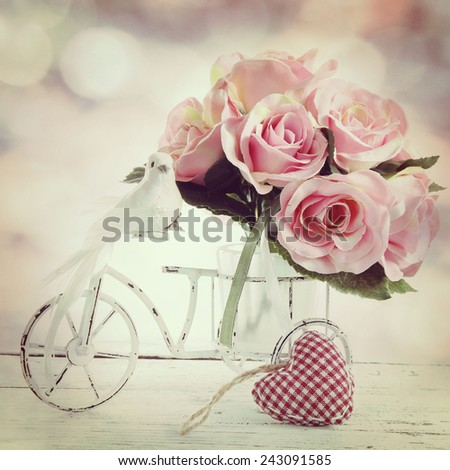 roses in a glass vase in vintage style - stock photo