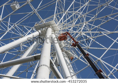 Rostov-on-Don, Russia- July 16:Construction of the Ferris wheel 65 meters. Two electrician repairing electric wires. Work carried out with the mounting tower