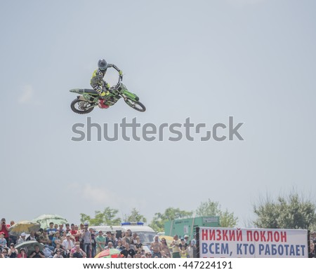 Rostov-on-Don, Russia- June 05,2016: Motofreestyle - jumps with incredible acrobatic elements that make professionals - stock photo
