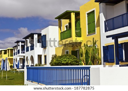 Row of modern two storey flat roof holiday homes by the seaside. - stock photo