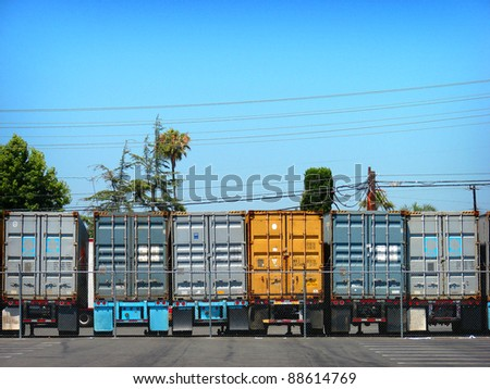 row of 18 wheel semi truck trailers - stock photo