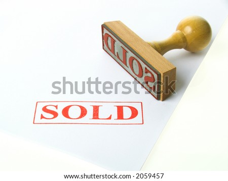 Rubber stamp SOLD - stock photo
