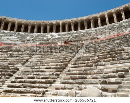 ruins of ancient amphitheater in Aspendos, Antalya, Turkey - stock photo
