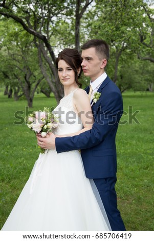 27.05.2016 Russia, Moscow, Park Kolomenskoye The groom kisses the bride in the forest