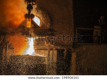RUSTAVI, GEORGIA - May 1, 2014: Hot steel pouring in Rustavi Metallurgical Plant, Georgia  - stock photo