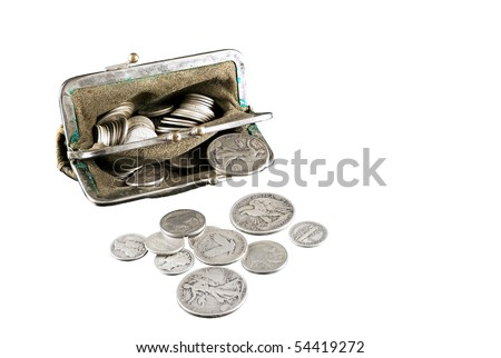 1930's and 40's silver U.S. coins in an antique pocket purse. - stock photo